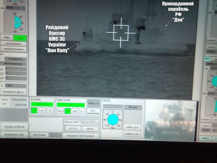 A Russian border guard vessel apparently tries to stop a Ukrainian navy tug boat. Pic: Ukrainian navy handout