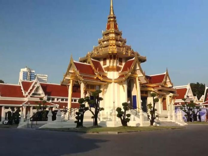 Mourners attend the final preparations in the temple before the Saturday ceremony in Bangkok