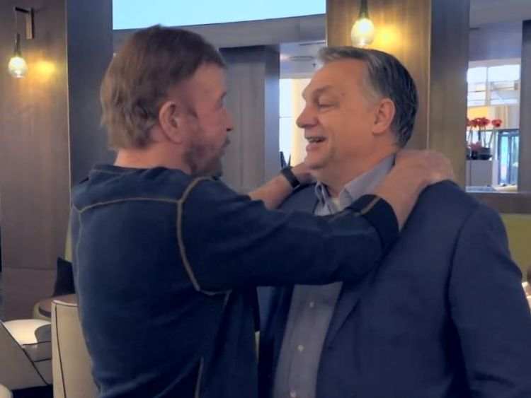 Chuck Norris, left, and Viktor Orban shared a hug. Credit: @orbanviktor