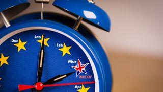 Retro alarm EU clock representing the countdown until Brexit. - Stock image