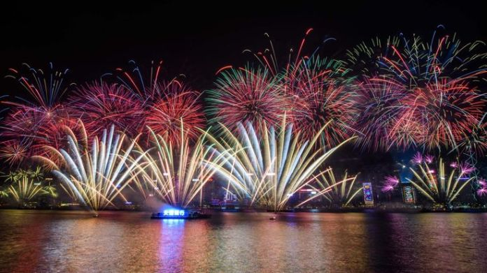 Fireworks explode over Victoria Harbour during New Year celebrations in Hong Kong