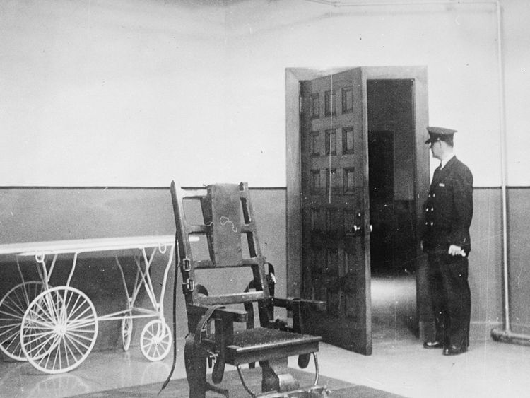 A prison guard stands in the Electric Chair room at Sing Sing Prison, New York, in 1951