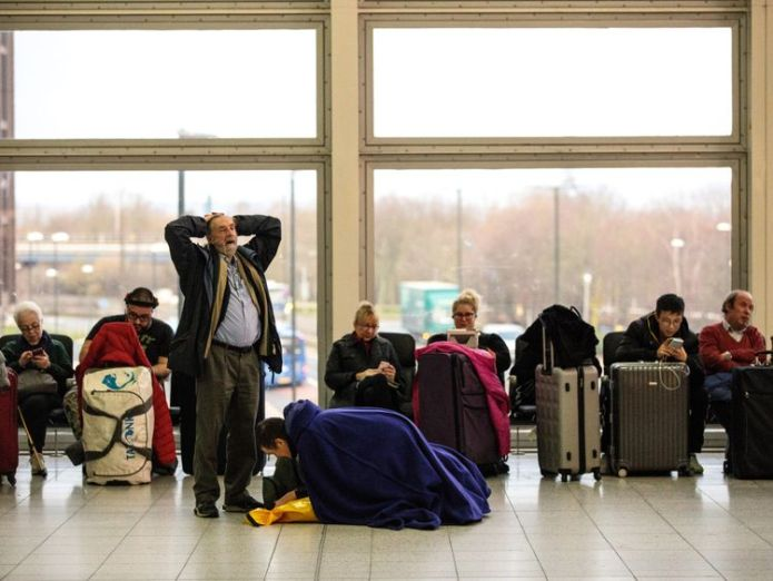LONDON, ENGLAND - DECEMBER 21: Passengers wait in the South Terminal building at London Gatwick Airport after flights resumed today on December 21, 2018 in London, England. Authorities at Gatwick have reopened the runway after drones were spotted over the airport on the night of December 19. The shutdown sparked a succession of delays and diversions in the run up to the Christmas getaway, in what authorities have called a 'deliberate act' to disrupt the airport. Police continue their search for
