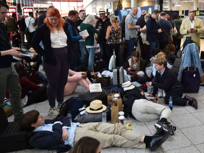 Passengers wait at the North Terminal at London Gatwick Airport