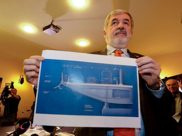 The design, held up here by the Genoa mayor Marco Bucci, resembles the bow of a ship
