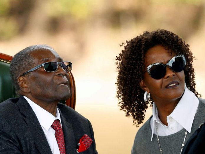 """FILE PHOTO: Zimbabwe's former president Robert Mugabe and his wife Grace look on after addressing a news conference at his private residence nicknamed """"Blue Roof"""" in Harare, Zimbabwe, July 29, 2018. REUTERS/Siphiwe Sibeko/File Photo"""