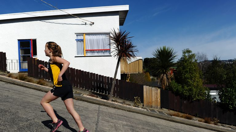 Competitors take part in a race up one of the world's steepest street in Dunedin, New Zealand on September 18, 2011