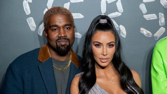 Kim Kardashian and Kanye West attend the the Versace fall 2019 fashion show in lower Manhattan on 2 December 2018 in New York City