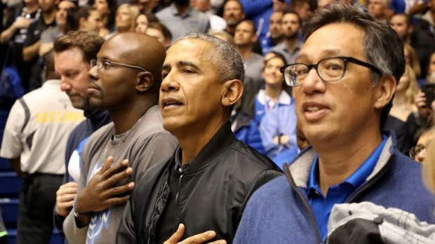 Barack Obama watches on during the game between Duke and North Carolina universities