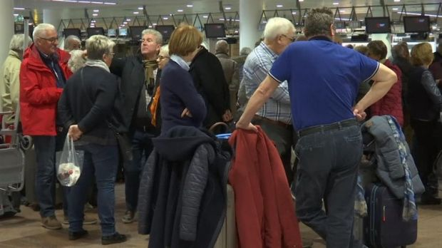 Passengers wait for information at Brussels airport