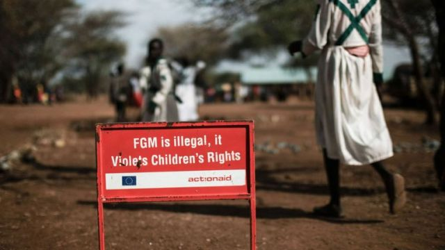 TOPSHOT - This photo taken on January 30, 2018 shows a warning sign against female genital mutilation (FGM) in Katabok village, northeast Uganda. The UN estimates that over 200 million girls and women have experienced FGM which is a life-threatening procedure that involves the partial or total removal of a woman's external genitalia. February 6, 2018, marks the 6th International Day of Zero Tolerance for FGM.