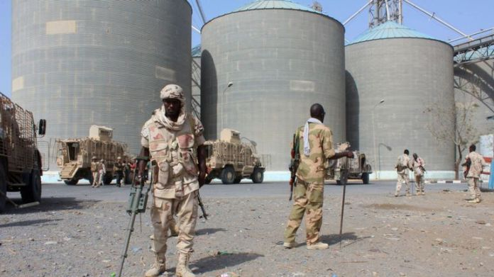 Troops who are part of a Saudi-backed military coalition detect mines at Red Sea Mills