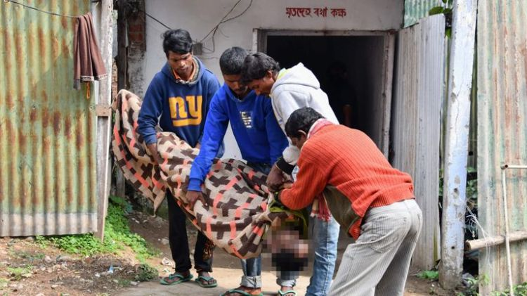 A dead victim of tainted alcohol is brought into hospital in Golaghat district in Assam