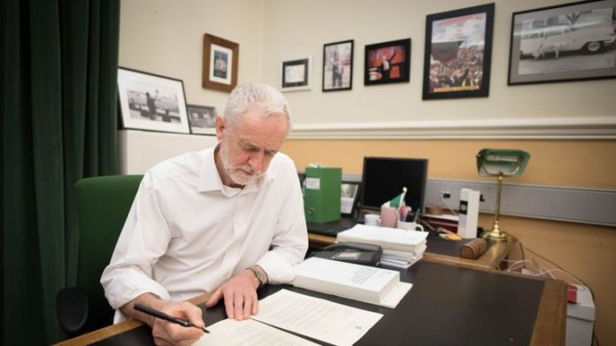 Labor Party leader Jeremy Corbyn signs a letter he wrote to Prime Minister Theresa May, outlining the Labor Party's five Brexit demands before leaving for Brussels.