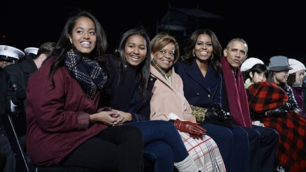 Michelle and Barack Obama with their daughters Malia and Sasha and Mrs Obama's mother Marian Robinson in 2015