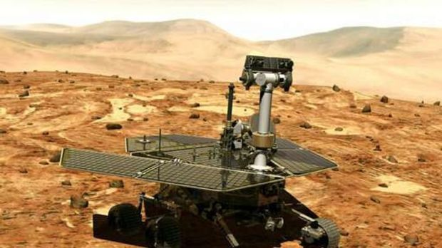 This illustration made available by NASA shows the rover Opportunity on the surface of Mars. The exploratory vehicle landed on Jan. 24, 2004, and logged more than 28 miles (45 kilometers) before falling silent during a global dust storm in June 2018. There was so much dust in the Martian atmosphere that sunlight could not reach Opportunity's solar panels for power generation.