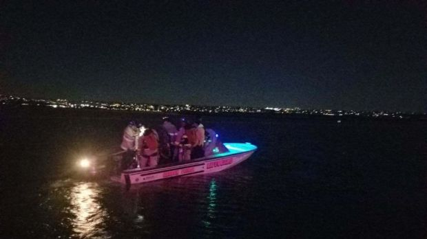 Visitors were lowered into boats with ropes and harnesses. Pic: San Diego Fire-Rescue Department