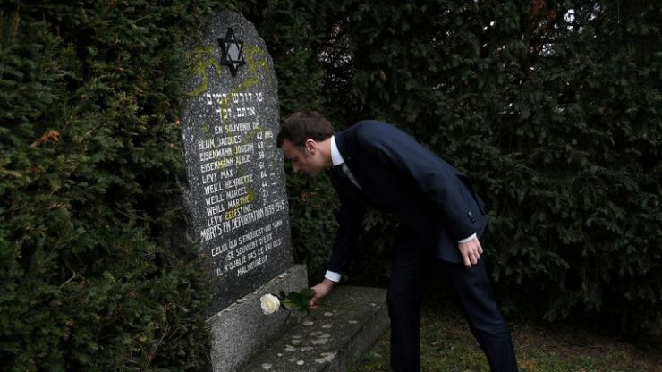 Emmanuel Macron paid his respects at a gravestone daubed with a swastika