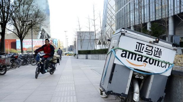 An electric bike used by Amazon sits parked along the pavement at a central business district in Beijing on November 29, 2012