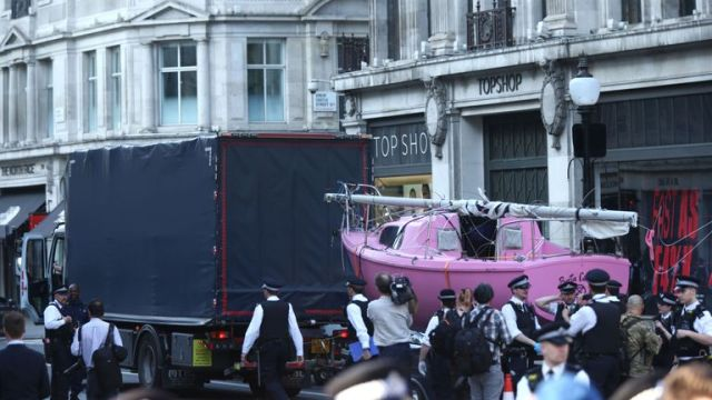 The Extinction Rebellion boat is towed away