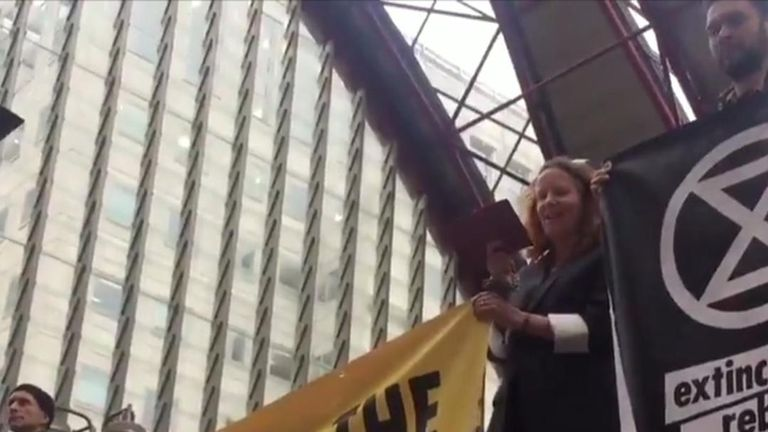 Climate change protesters stand on a train at Canary Wharf