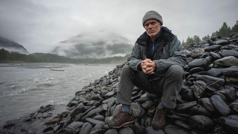 Jeremy Wade sitting on rocks by a river in Port Fidalgo, Prince William Sound, Alaska. Pic: Animal Planet