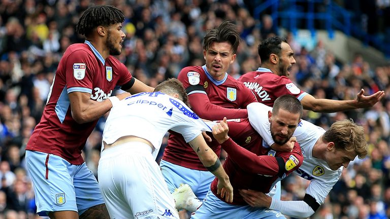 Leeds United's Mateusz Klich is confronted by Aston Villa's Conor Hourihane after he scores his side's first goal while Villa's Jonathan Kodjia was down injured