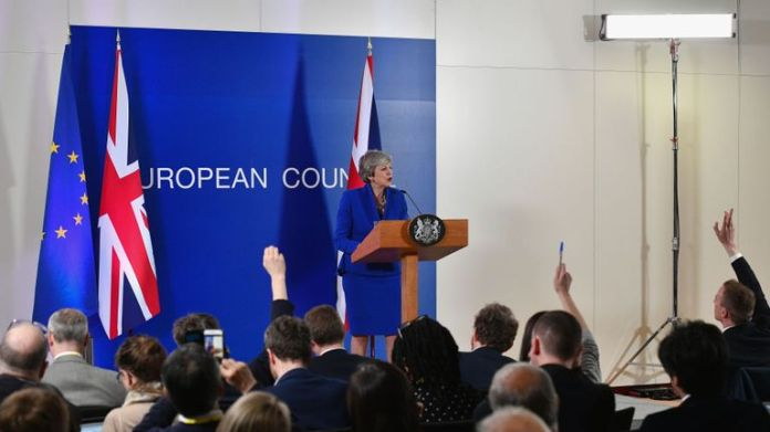 Theresa May speaks at a press conference at the headquarters of the Council of the European Union in Brussels
