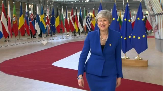 Theresa May appeared in good spirits when she arrived in Brussels