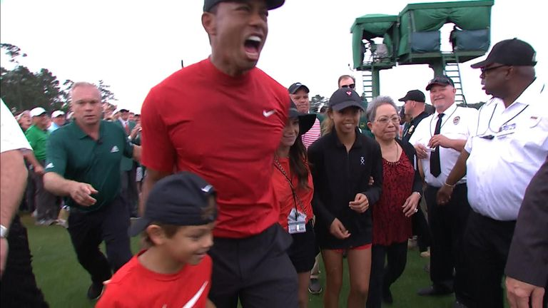 Tiger Woods and his family following his win