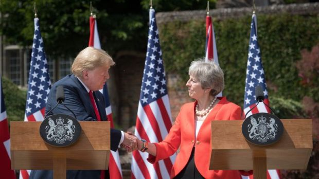Mrs May and Mr Trump shake hands at Chequers