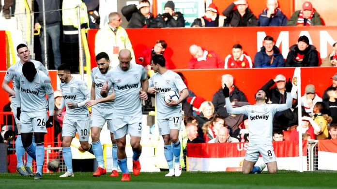 West Ham players celebrate scoring at Old Trafford on Saturday