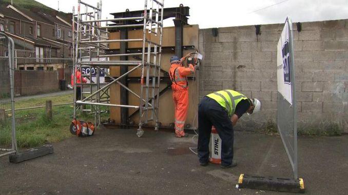 Workmen were cutting away the mural