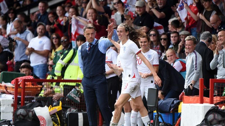Philip Neville, Head Coach of England Women congratulates Jill Scott after she scores her team's second goal during the International Friendly between England Women and Denmark Women at Bank's Stadium on May 25, 2019 in Walsall, England. (Photo by Nathan Stirk/Getty Images)