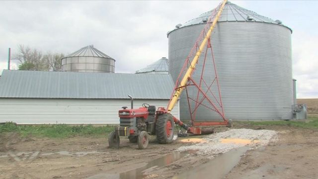 Mr Kaser got his leg stuck in this red grain auger. Pic: ABC News