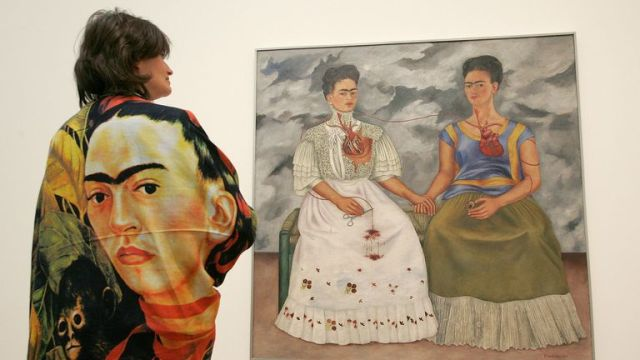 Emma Dexter, looks at 'The Two Fridas', a painting by artist Frida Kahlo, at the Tate