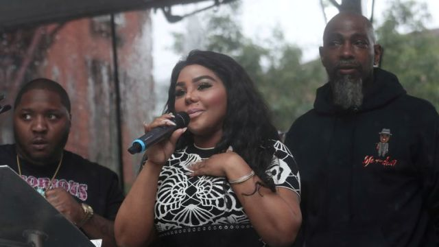 """Rap singer Lil' Kim speaks at the street naming ceremony for Christopher """"Notorious B.I.G"""" Wallace way in the Brooklyn borough of New York, U.S., June 10, 2019. REUTERS/Shannon Stapleton"""