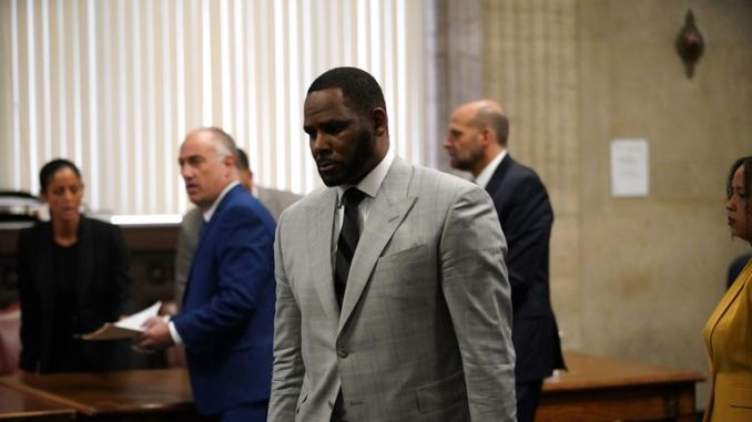 R. Kelly pleads not guilty to a new indictment before Judge Lawrence Flood at Leighton Criminal Court Building in Chicago on June 6, 2019. - R&B star R. Kelly pleaded not guilty Thursday in a Chicago courtroom to 11 new felony sex crime charges. The charges were a refiling of one of the four cases of alleged abuse that prosecutors lodged against the singer earlier this year. (Photo by E. Jason Wambsgans / POOL / AFP) (Photo credit should read E. JASON WAMBSGANS/AFP/Getty Images)