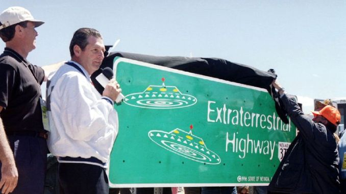 Nevada Governor Bob Miller presides over the unveiling of a new road sign for Nevada State Highway 375 in Rachel, about 150 miles north of Las Vegas. 1996