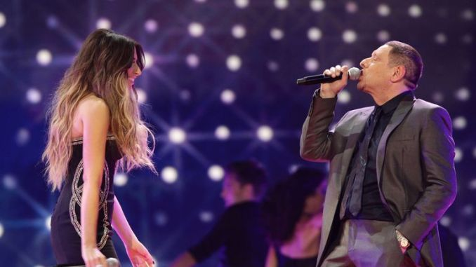 Stacey Solomon and Shaun Ryder on stage during the 2011 National Television Awards at the O2 Arena