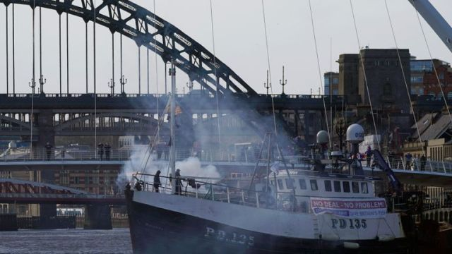 NEWCASTLE, ENGLAND - MARCH 15: A boat releases a flare near the Millennium Bridge on the River Tyne during the Fishing For Leave flotilla on March 15, 2019 in Newcastle, United Kingdom. Fishing for Leave are supporting other Pro-Brexit groups who are calling for the Government to scrap the Withdrawal Agreement and for MP's to ensure that Britain leaves the EU with no deal. The flotilla marks the official launch of the 'March to Leave' walk that begins the following day and will make its way to London in 14 stages arriving on March 29, the original date for the UK to leave the European Union.(Photo by Christopher Furlong/Getty Images)