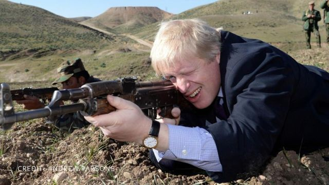 Mr Johnson poses with a gun. Pic: Andrew Parsons