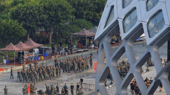 Chinese soldiers march in formation on Shenzhen Bay Sports Center field in Shenzhen