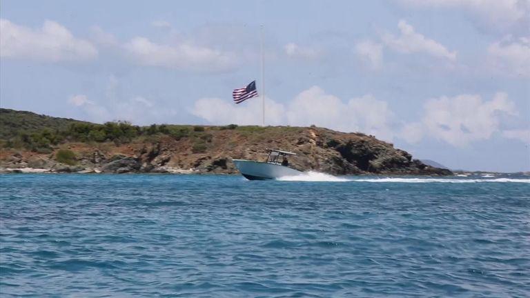 A flag at half mast on the island