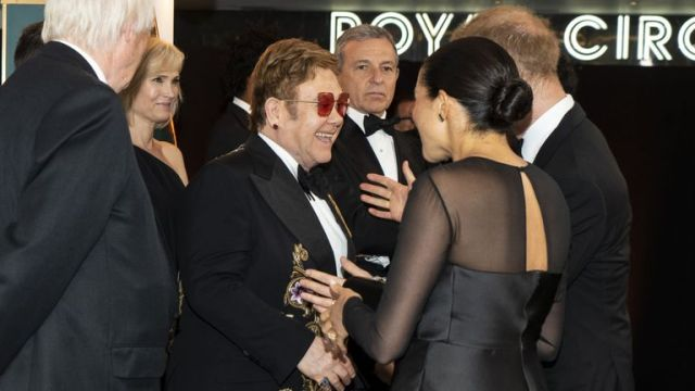 """Prince Harry, Duke of Sussex and Meghan, Duchess of Sussex greet British singer-songwriter Elton John and David Furnish at the European Premiere of Disney's """"The Lion King"""" at Odeon Luxe Leicester Square on July 14, 2019 in London, England"""