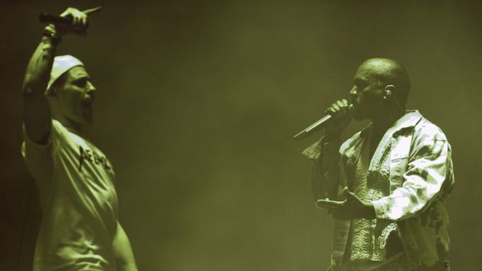 Comedian Simon Brodkin (L), playing his character Lee Nelson, interrupts singer Kanye West on the Pyramid Stage at the Glastonbury Festival at Worthy Farm near the village of Pilton in Somerset, South West England, on June 27, 2015