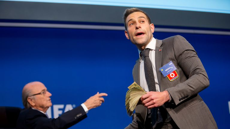 Comedian Simon Brodkin/ Lee Nelson prepares to attack FIFA President Joseph S Blatter (R) with money during a press conference at the Extraordinary FIFA Executive Committee Meeting at the FIFA headquarters on July 20, 2015 in Zurich, Switzerland