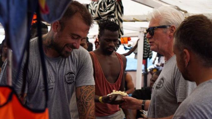 American actor Richard Gere sharing a meal with migrants aboard a ship that has rescued 121 people from the sea Courtesy: Open Arms Facebook page