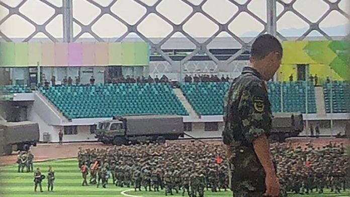 Chinese soldiers gather at Shenzhen Bay Stadium in Shenzhen on the border with Hong Kong