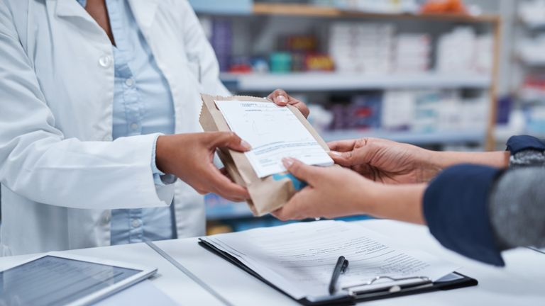 Closeup shot of an unrecognizable pharmacist assisting a customer in a chemist